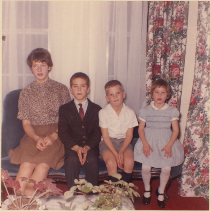Costumed for Thanksgiving: from left, my siblings Liz, T, Sam, and me
